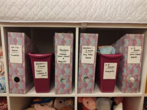 magazine holders with baby clothes inside cubby system